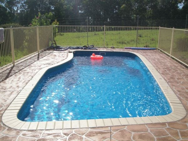 Signature pools swimming pool designs construction 1 for Pool design polen