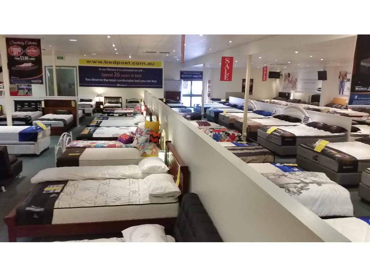 Bedpost beds r us furniture stores shops 524 stuart for Furniture stores in us