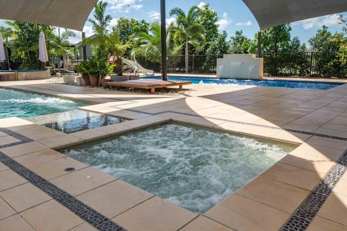 Leisure pools sydney swimming pool designs for Pool design sydney